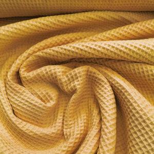 Tela waffle o tela gofre color mostaza