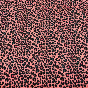 Tela PUL estampado de animal print en color coral y print gris