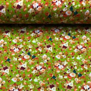 Tela con mucha caída de viscosa,ideal para verano, con estampado de flores de primavera en fondo verde